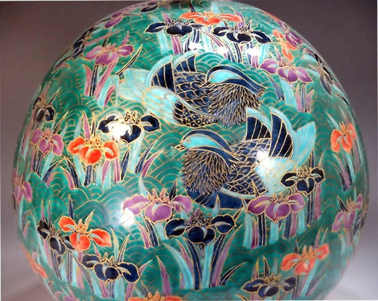 Dramatic Japanese contemporary decorative porcelain vase, intricately gilded and hand-painted on a beautifully shaped large body in green, a signed masterpiece by a Japanese master porcelain artist. Working in the historic Imari-Arita region of