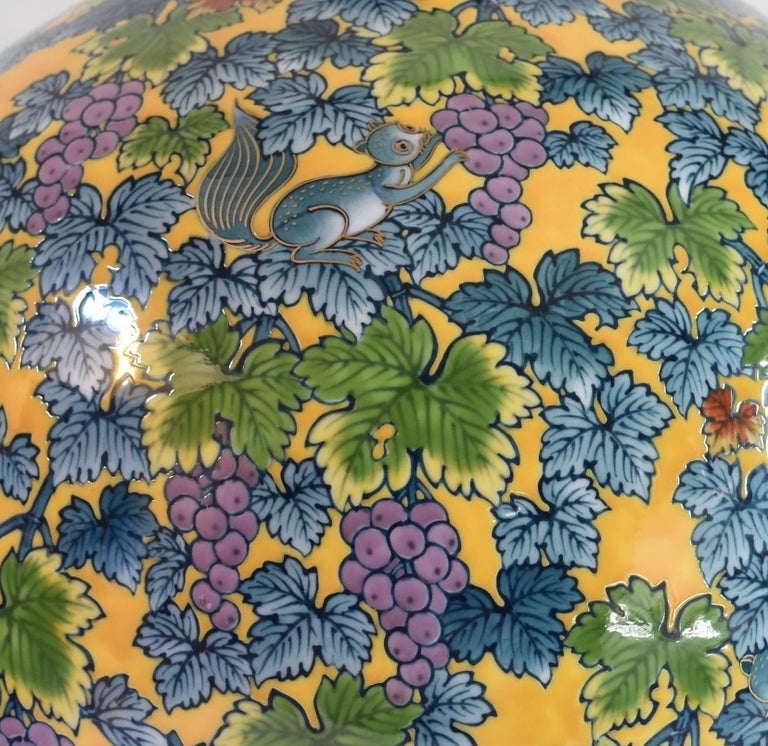 Attractive large Japanese contemporary decorative vase, hand-painted on a beautifully shaped high quality porcelain body in vivid yellow, blue and green, a signed piece by highly acclaimed award-winning master porcelain artist of the Imari-Arita