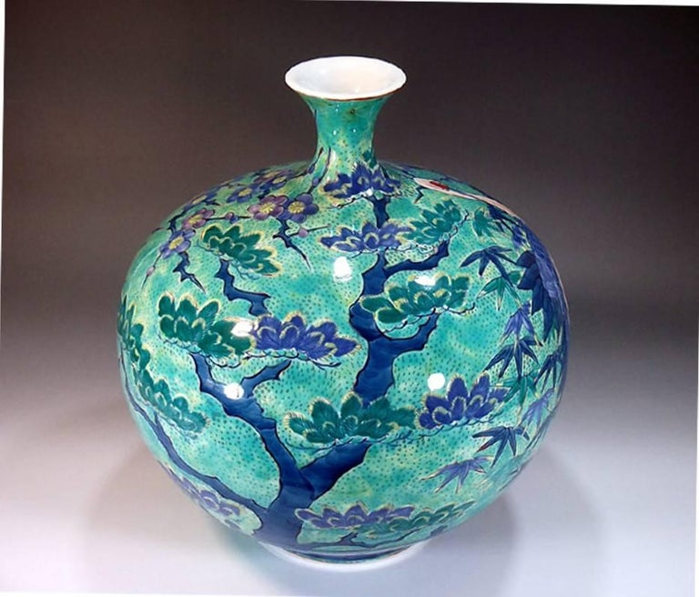 Large intriguing Japanese decorative porcelain vase, hand-painted on a beautifully shaped ovoid pure white porcelain body, a signed work by a highly acclaimed master porcelain artist of the historic Imari- Arita region of southern Japan. This artist