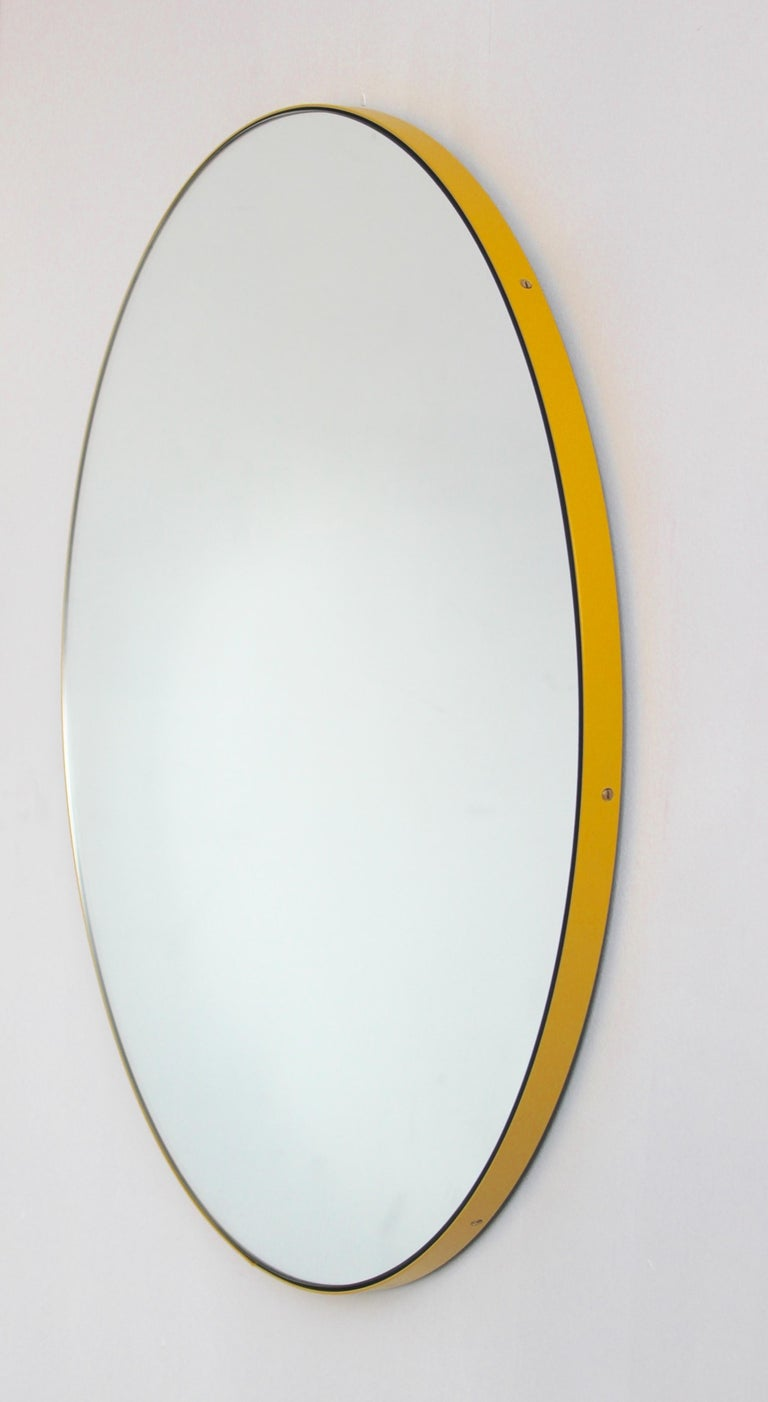 Delightful handcrafted silver round mirror with a modern yellow frame (powder coated aluminium).