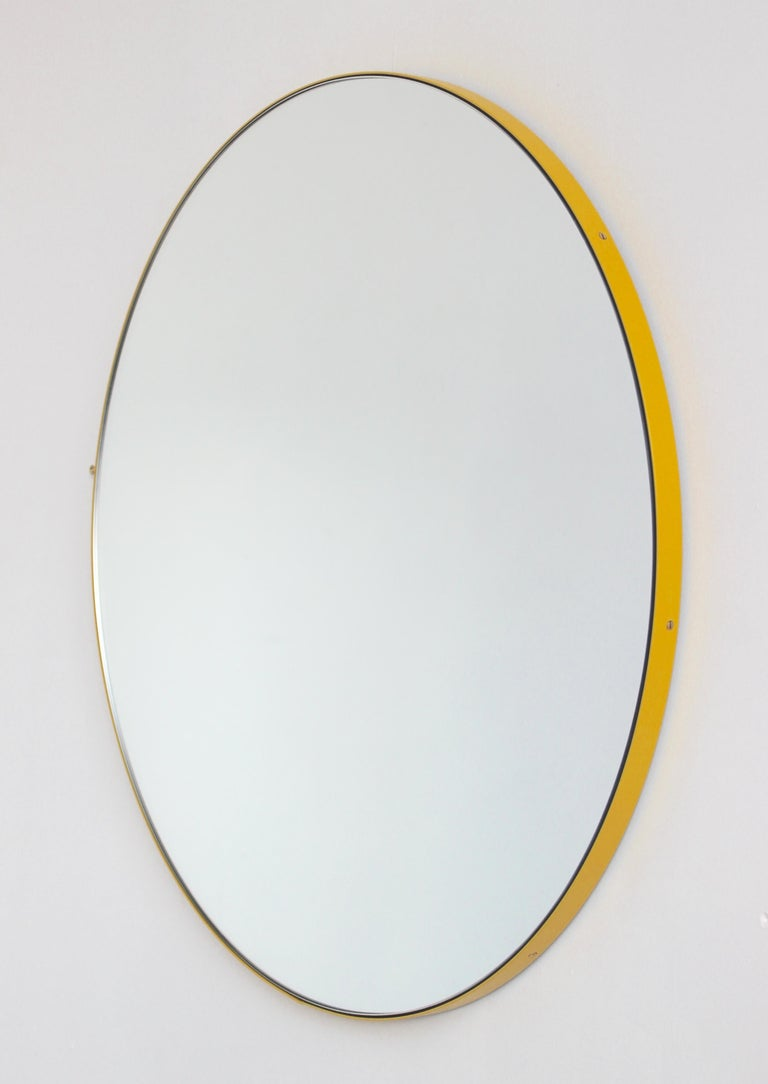 Delightful handcrafted silver round mirror with a modern yellow frame (powder coated aluminium).  Ideal above a console table in the hallway, above a beautiful fireplace, in the bedroom or in the bathroom.  Design tip: looks stunning used as a