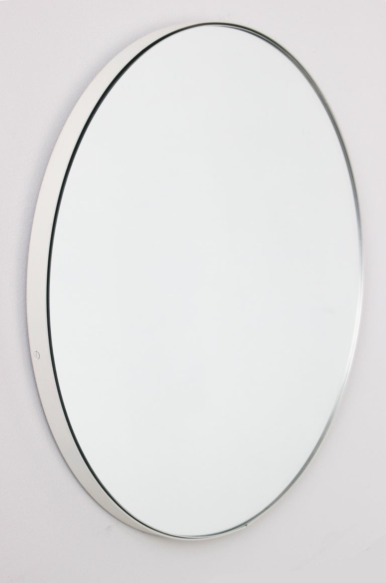 Delightful crafted silver round mirror with an elegant white frame. Made in London, UK.