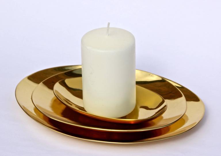 Polished Set of Handmade Cast Brass Plates For Sale