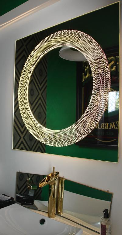 Sleek, elegant, modern, featuring cutting edge technologies lifting the bathroom experience to brand new heights.  The Glazz Cosmic mirror adorns a stunning circular pattern that comes alive when back-illuminated. Light also beautifully shines