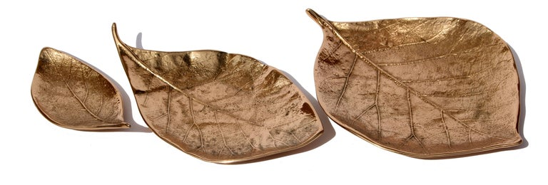 Cluster of splendid bronze leaves, each of which is handmade individually with incredible detail.  Cast using very traditional techniques, they are polished capturing the raw finish of this noble material, and impressively highlighting every vein