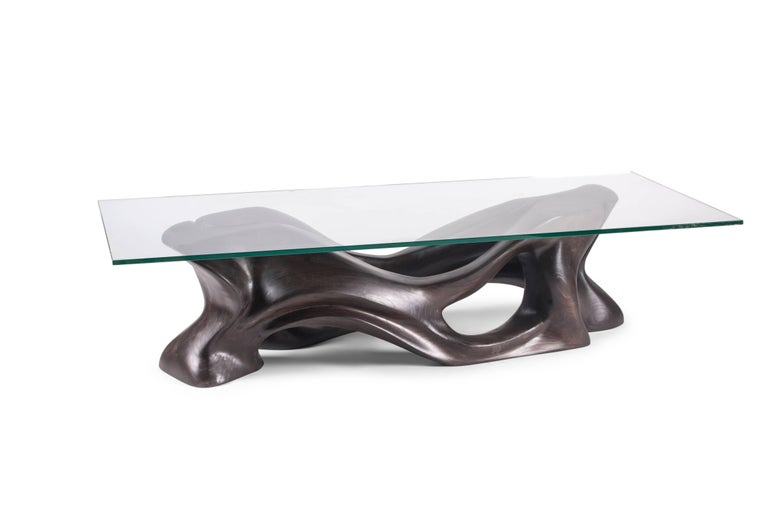 Crux coffee table is a stylish futuristic sculptural art table with a dynamic form designed and manufactured by Amorph. Crux Table consists of two identical pieces that join together to create elegant shape. The dimension of base is 52.25