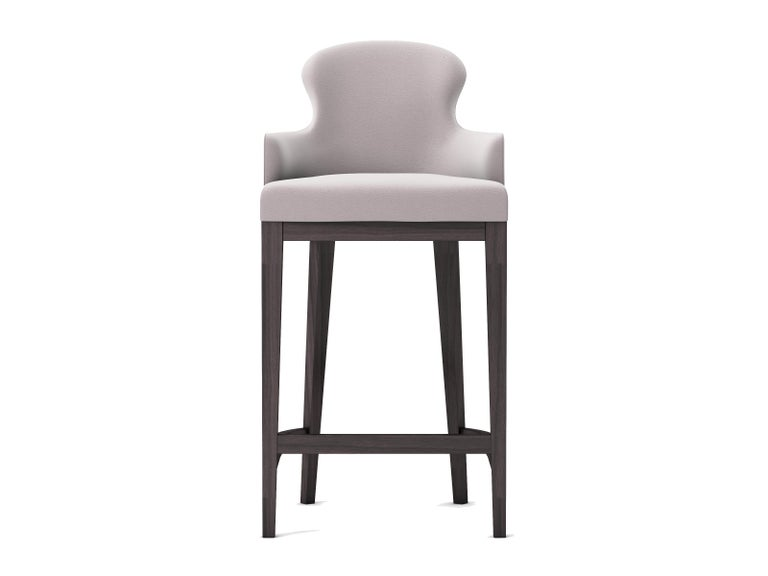 Outdoor-Indoor Coco Wolf Sammarco bar stool  Internal construction: WPB mortice and tenon joined hard wood frame. Galvanised spring base. Marine grade webbing. All exposed wood is Iroko cushions: Patented Peltluxé® fibre cushion interior and