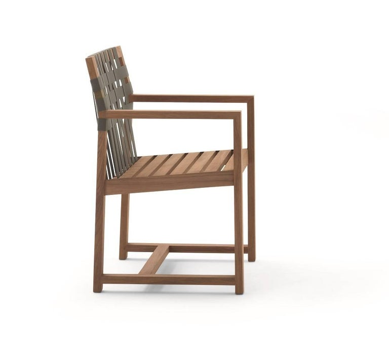 Roda network 159 armchair made in solid teak wood and grey polyester belts.  For outdoor use.