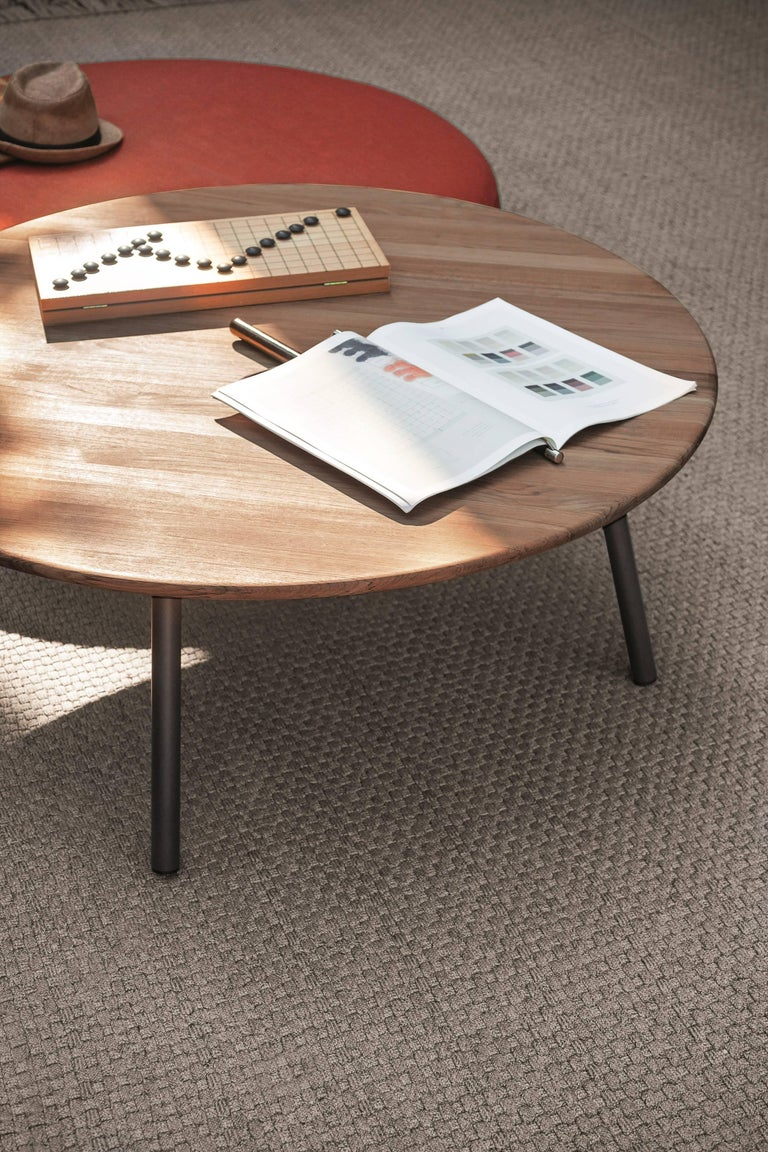 Low tables complement the Piper collection, offering versatile combinations, suitable for fitting a wide variety of spaces, and for meeting a broad range of needs. Rust colored powder coated legs with teak top.  Teak Quality The grade of our teak