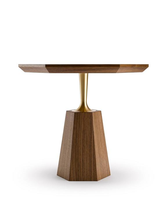 The Hex Occasional Table has a hexagonal tapering base giving rise to a precision engineered brass neck that supports a hexagonal top, shown here in natural oiled walnut and machine turned solid brass. The brass is available in either a natural or