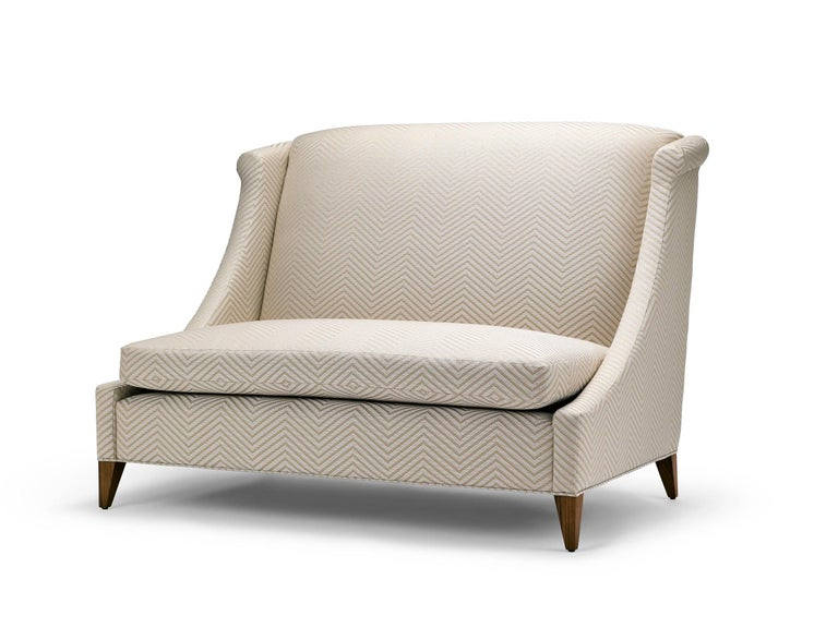 The Vegas sofa, similar to our Vegas lounge chair features a pronounced high back and sweeping curved arms. The Vegas sofa is shown here upholstered in Jim Thompson Blake Trevira. The geometric chevron pattern has been carefully matched across the