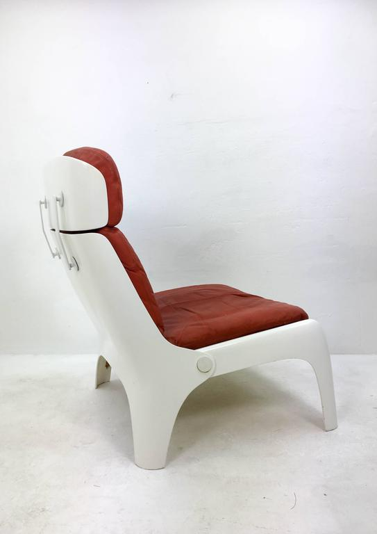 Futuristic 1970s lounge chair. Original red leather upholstery on a polyester frame.