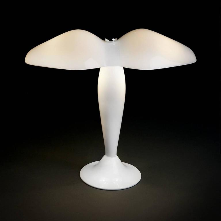 Milk white mouth blown and hand finished Murano glass table lamp designed in 1994 by Carlo Moretti.   2 x 40 watt incandescent bulbs, 2 x 28 watt ecolamp socket E14.   Carlo Moretti: An artisan factory  Strolling afoot through the foundations