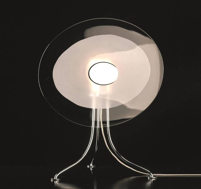 Table lamp with three rod base in polished chrome and flat vertical hand made shade in transparent and polished Murano crystal using the