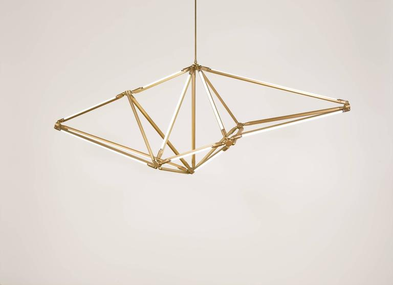 The Shy light uses the spare beauty of thin LED tubes to define the edges of its shape; in this way the function of the piece is created by its form, and vice-versa. It is also inspired by crystalline structures, both by the shapes they take as well