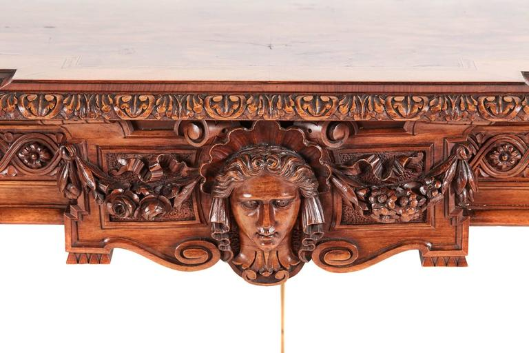 A fine and rare pair of French carved walnut console tables, with quality burr walnut tops, inlaid chequered banding, crossbanded in walnut with a fine carved edge, an amazing carved solid walnut frieze to the centre of the frieze is a beautiful