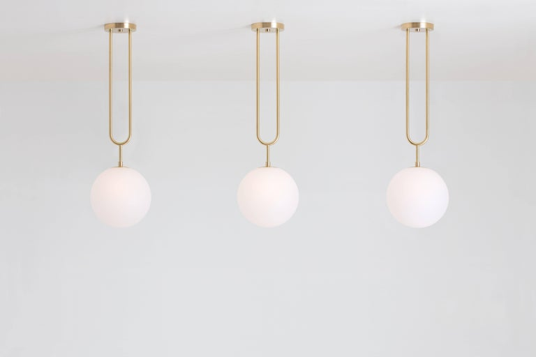 Art Deco Koko, a Modern Pendant Light with Satin Globe Shade in Brushed Brass Finish For Sale