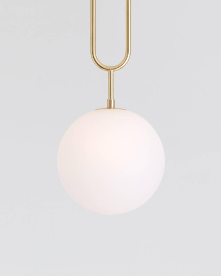 American Koko, a Modern Pendant Light with Satin Globe Shade in Brushed Brass Finish For Sale