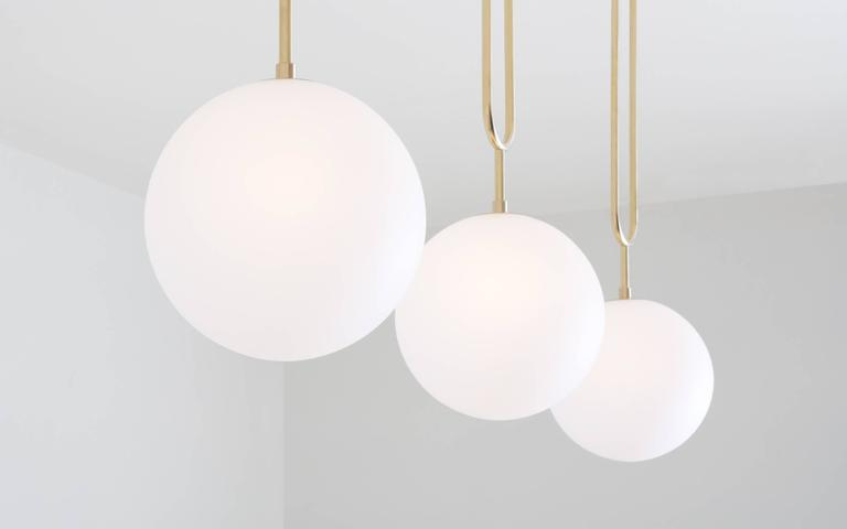 Koko, A Modern Pendant Light with Satin Globe Shade in Brushed Brass Finish In New Condition For Sale In Portland, OR