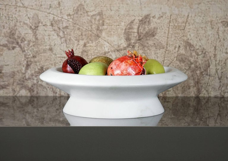 White marble centrepiece, inspired by Caravaggio's basket of fruit, it shows off marble in an extremely realistic dimension. Size: 36.5 x 10 cm, smooth finishing. Commercial name: Amaltea, Materia e Tavola Collection by the Spanish Designer Ivan