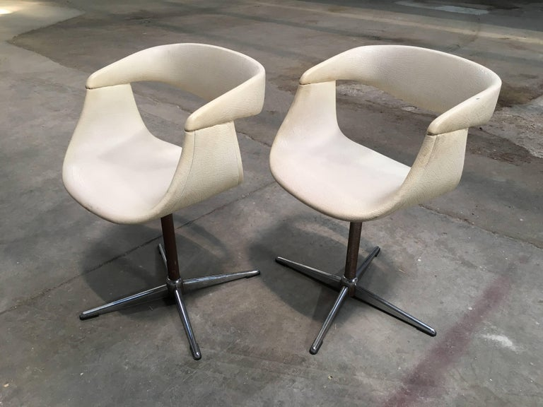 Pair of Italian swivel chairs in the style of Pierre Paulin with eco leather from 1960.