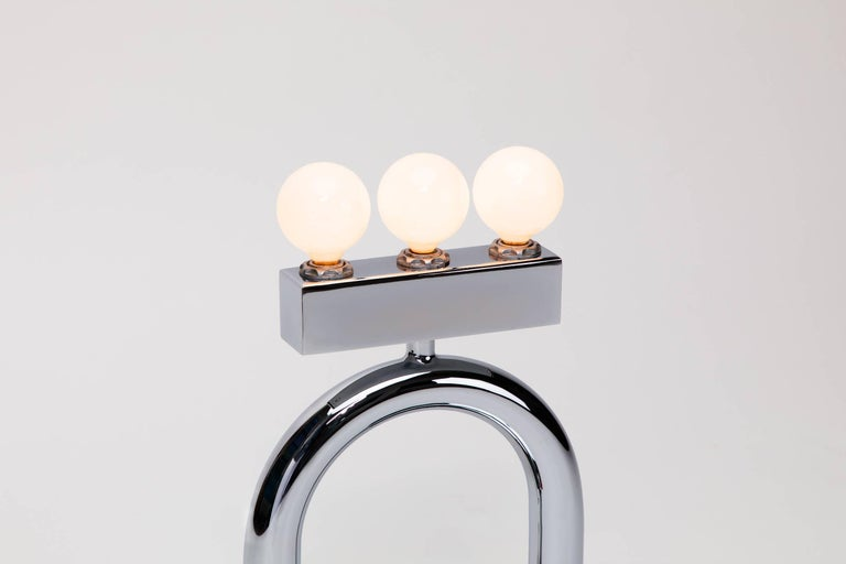 Inspired by the curvy chrome Italian lighting designs of the late 1960s and 1970s as well as the animated shapes and totems of the Memphis Group, the Sophia lamp is both elegant in finish and playful in form. This sculptural chrome-plated table lamp