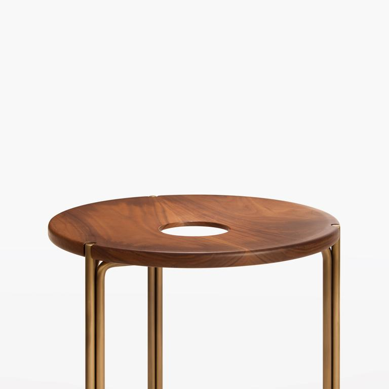 "Available in several custom material and finish options - walnut top/burnished brass frame presented in the image above.  Optional leather seat pads available.  Measures: 16"" diameter x 18"" H / 40.6 cm diameter x 45.7 cm H."