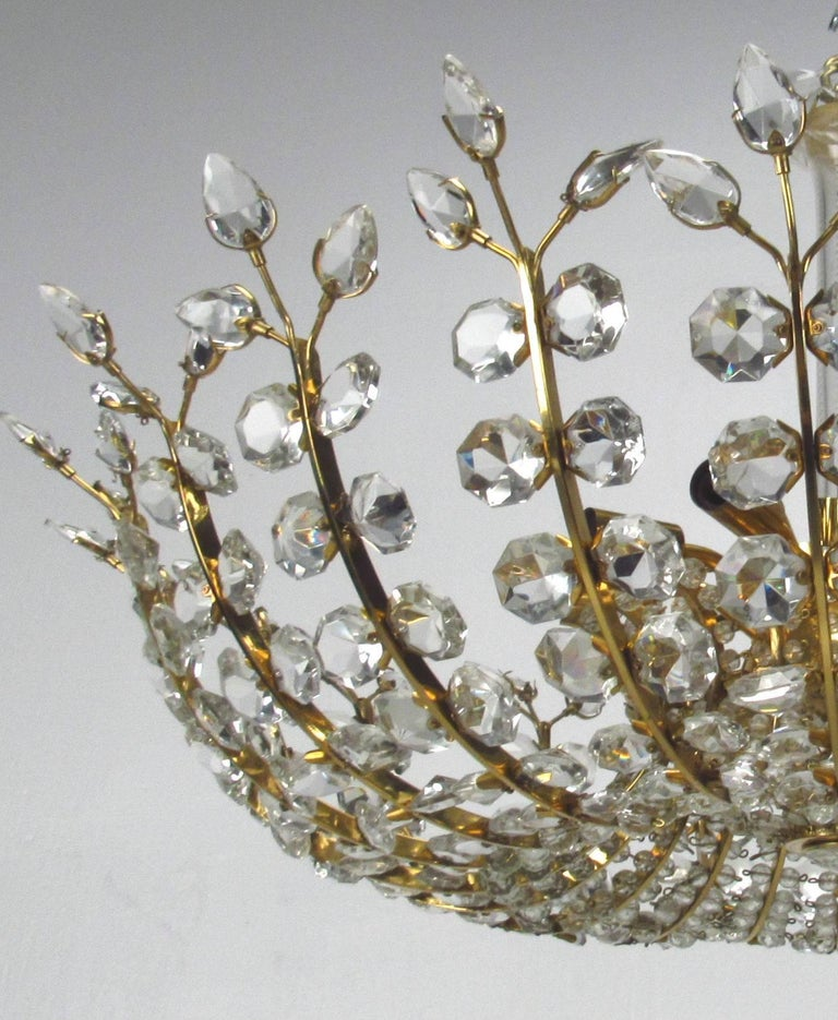 Crystal Chandelier by Oswald Haerdtl for Lobmeyr, circa 1950s.  This spectacular chandelier has fifteen candelabra E14 sockets and one E14 socket downwards oriented in the center.