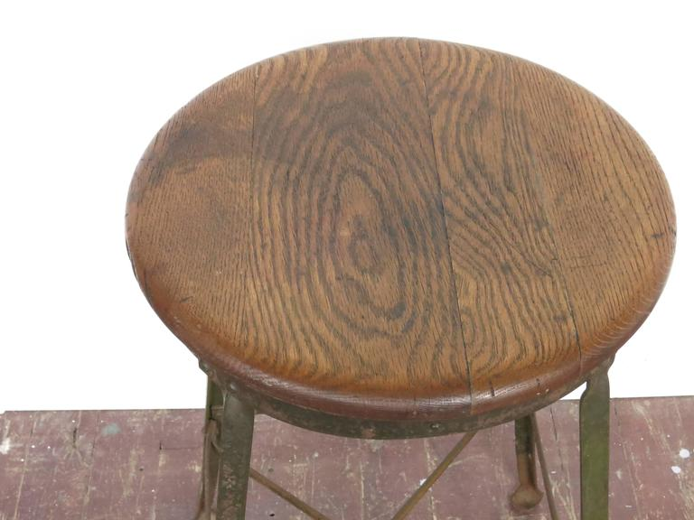 Vintage angle steak Industrial stool, 27' high. Seat is 13.5