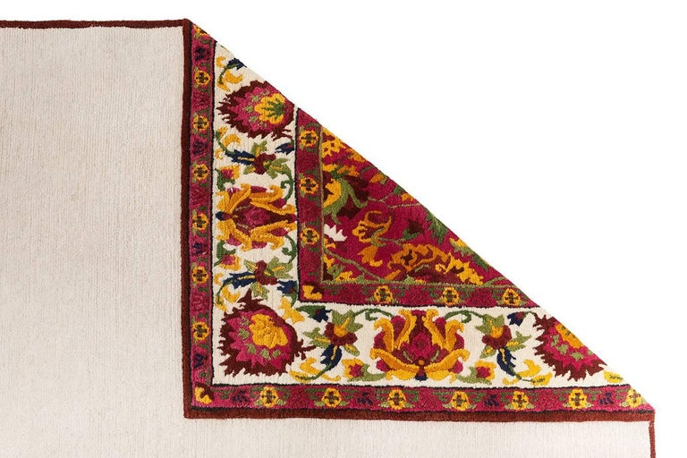 A hand-knotted rug is wool, with 100 knots per square inch (155.000 per square meter).