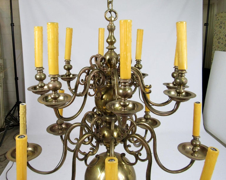 Early 20th century Dutch brass chandelier with two-tier and sixteen lights.