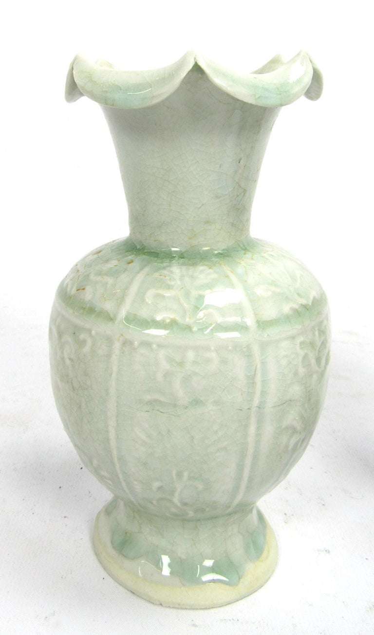 Set of two early 20th century Celadon vases with flared peaked rims.
