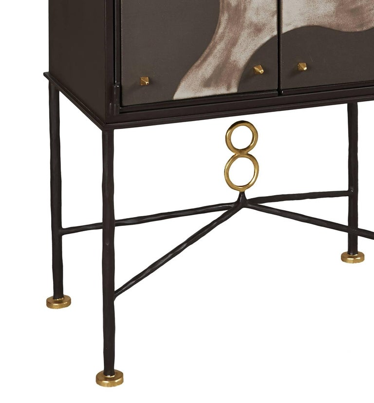 Cabinet, unique piece by Elizabeth Garouste. Wrought iron and bronze patinated, gilded parts, external parts of the doors in ceramics. Wooden inside.