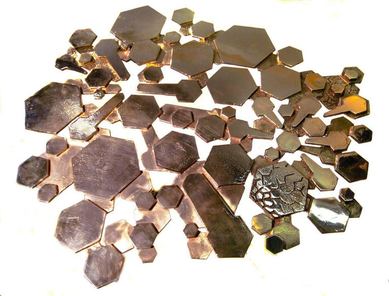 Polished bronze gueridon table.