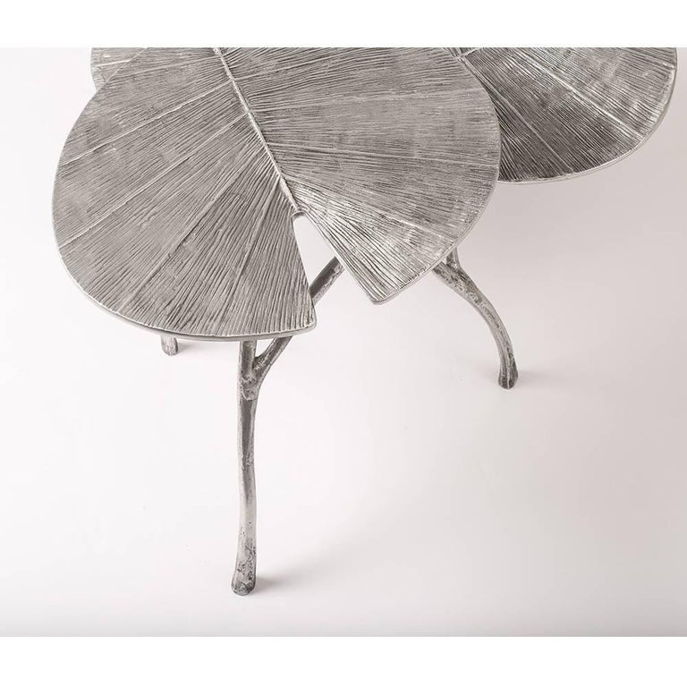 Aluminum table, composed of three leaves of three different heights 43/33/28 cm.