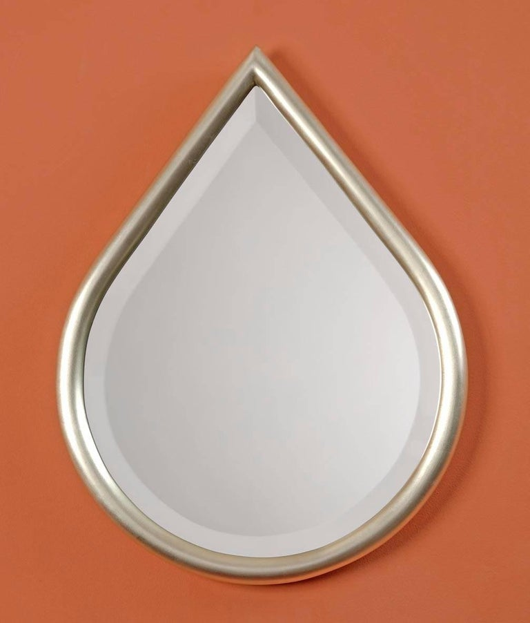 Gilded bevelled mirror in the shape of a drop.