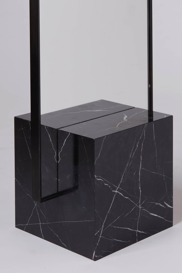 Nero Coexiststanding mirror with black concrete rubber CYL   Black speckled rubber back  Black steel frame.