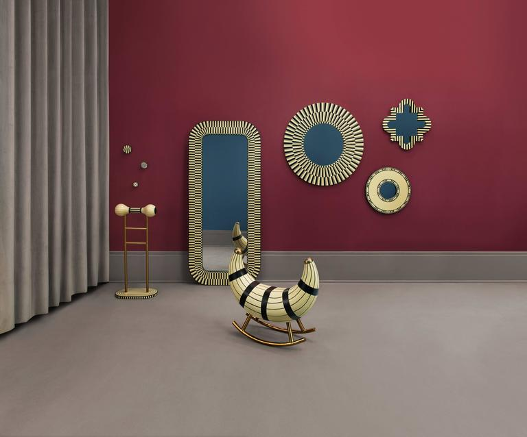 Nanook of the North is an exquisite rocking seat with metal legs in gold in MDF, Plywood and Resin Inlay. Ideal for a residence, hotel or office.  Each piece in the Vanilla Noir collection exalts the handmade, the painstakingly crafted, the