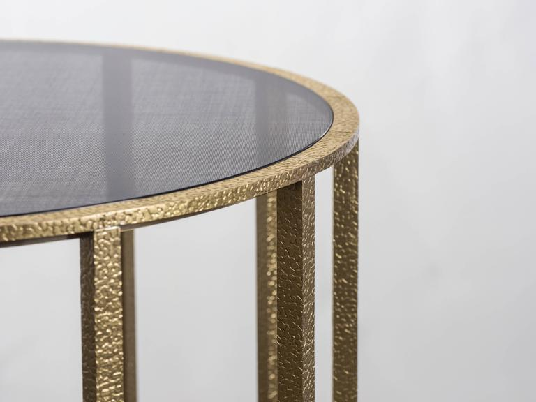 Round 'Drum' table 45 cm diameter x 50 cm height. Polished stamped brass with fabric inlay glass.