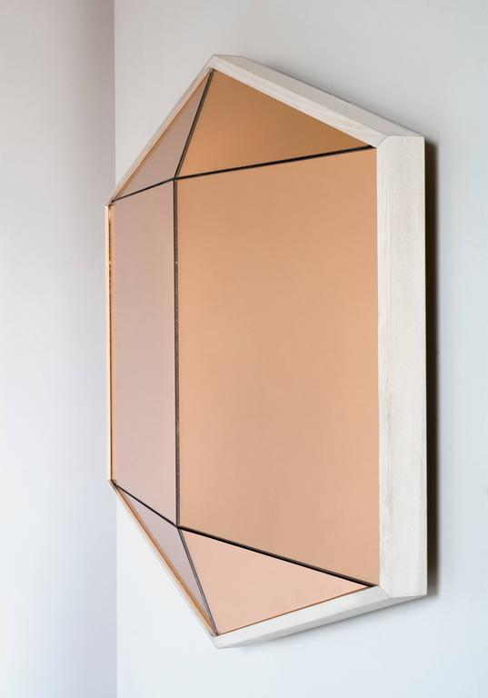 Built in colored mirror with a hardwood frame, the Gem mirror offers a bold reflective surface. Six faceted panes of glass are a trick to the eye walk past and one's reflection seems to appear and disappear. 
