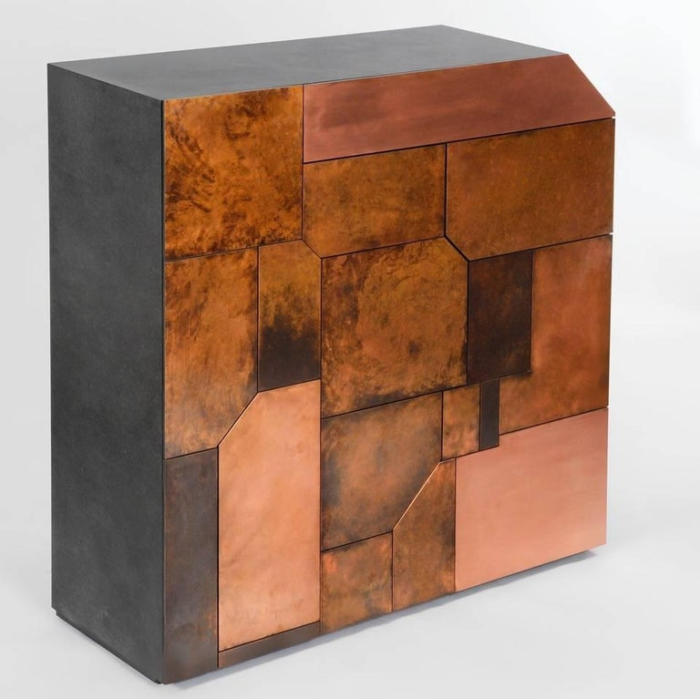 The Elementi Patina Copper Cabinet is a monolithic, yet sumptuous piece of sculptural furniture. Although contemporary in design, it's art-deco design notes and luxurious copper front allows it to harmonize with a wide range of décor styles.  The