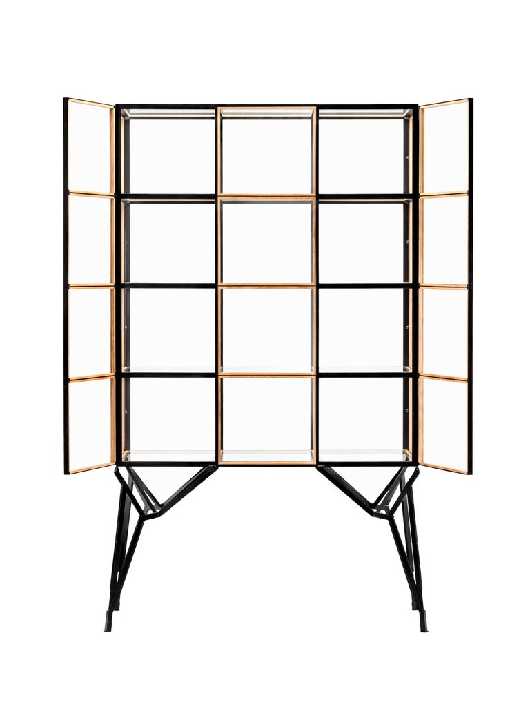 A timeless cabinet with a modular design and concealed doors to display treasured items. Inspired on the demolished Philips factory buildings of Eindhoven and their windows. Handcrafted wooden glass-slats holding glass panels set in a ingeniously