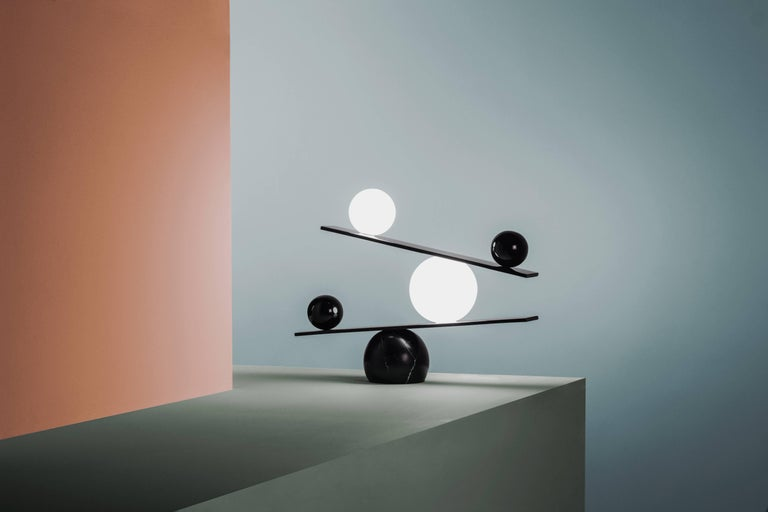 The Balance table lamp is Victor Castanera first product for Oblure. The fixed impossible position of the orbs is an expression of the fragility of existents. All entities move and nothing remain still. Balance is a play with the concept of time –