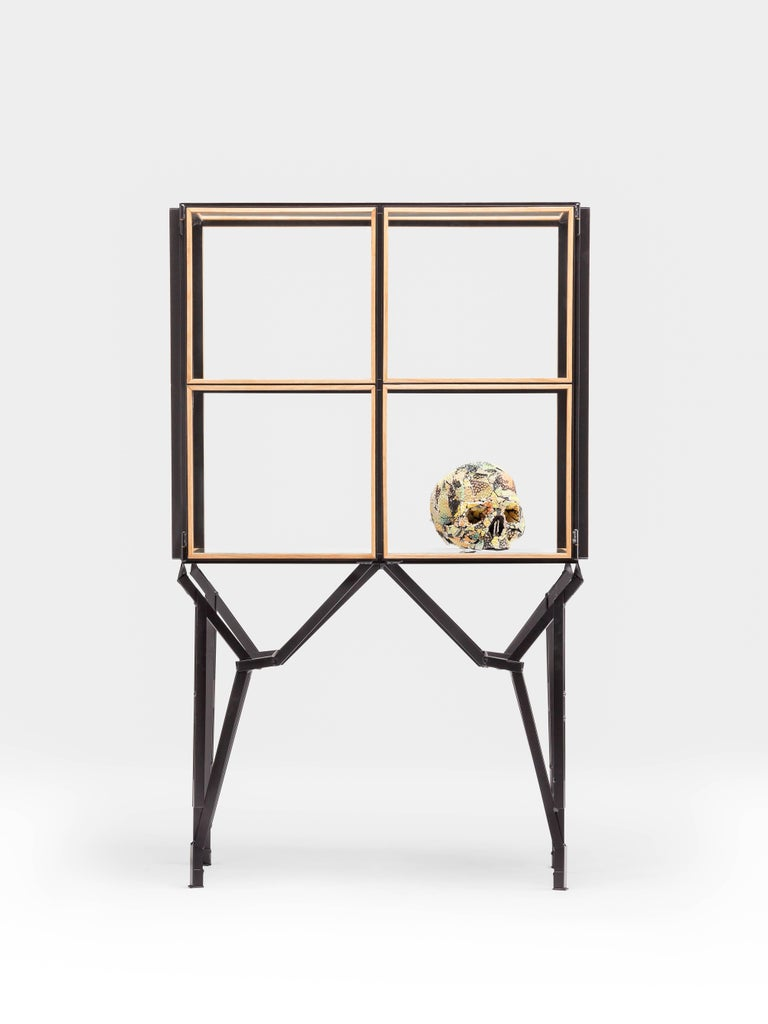 A timeless 2 x 2 cabinet with a modular design and concealed doors to display treasured items. Inspired on the demolished Philips factory buildings of Eindhoven and their windows. Handcrafted wooden glass-slats holding glass panels set in a