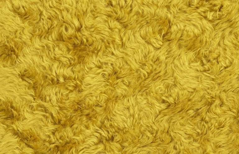 Dedicated to all the broken hearts, Uni represents both separation and unification of souls.   Uni is upholstered with %100 mohair from Angora goats. The deep curly pile creates the sensation of being enveloped, while also catching light.