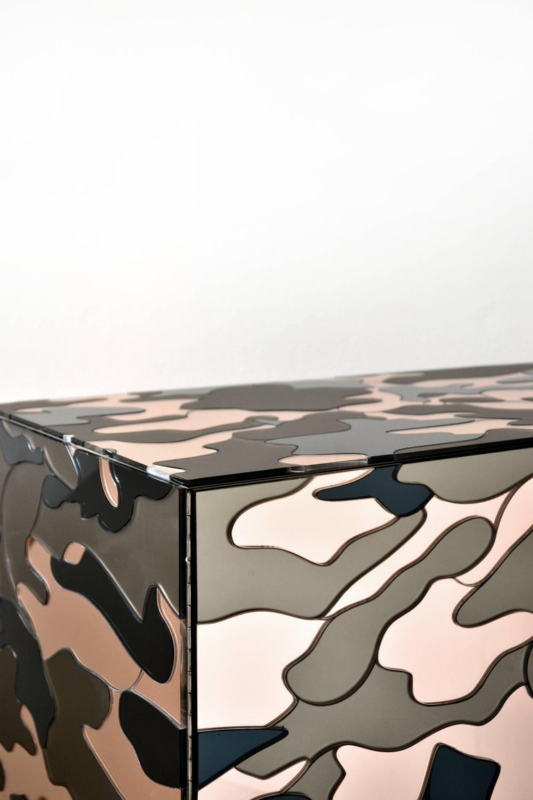 Camouflage cabinet by Effetto Vetro  Cabinet in wood composed of three types of mirrors: Pink mirror, satin bronze mirror, black mirror. Push up opening. Legs in steel.  Handmade in Italy  Unique piece, 2016.