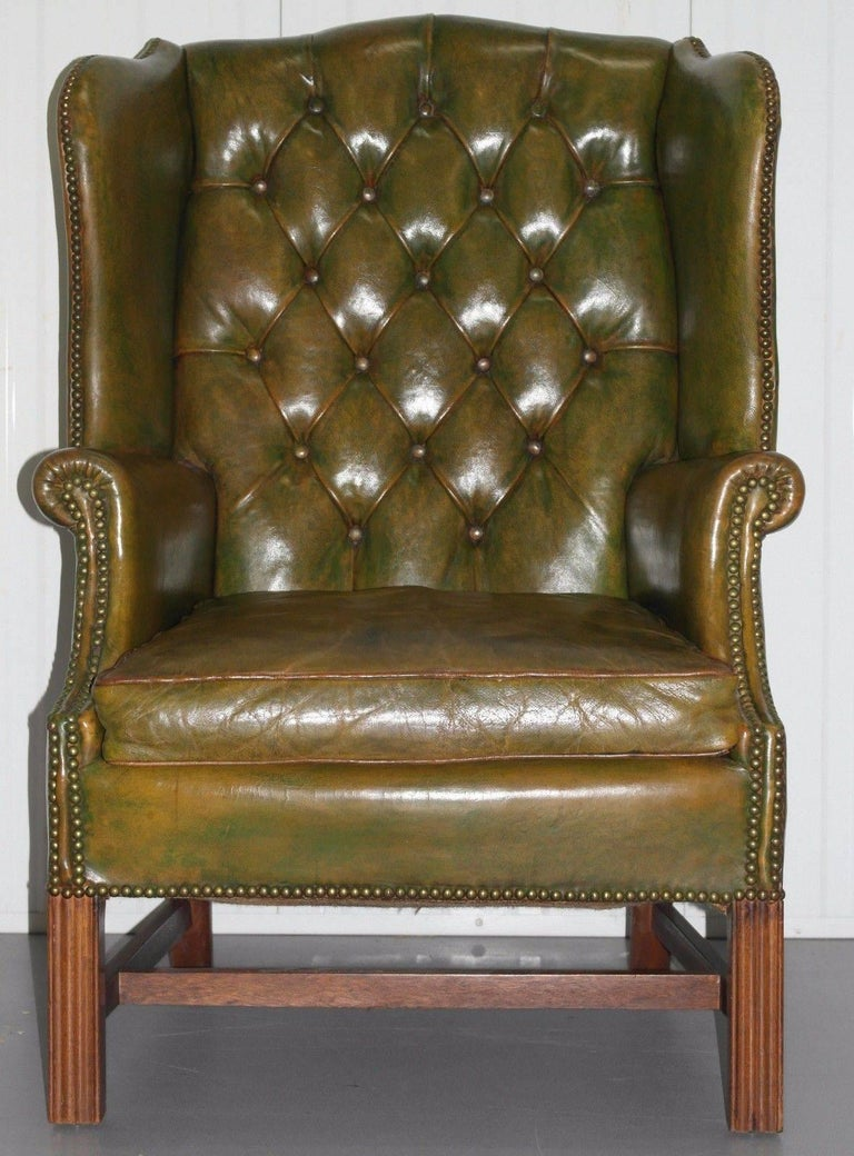 British Georgian Chesterfield Aged Green Leather Wingback Fireside Armchair, George III For Sale