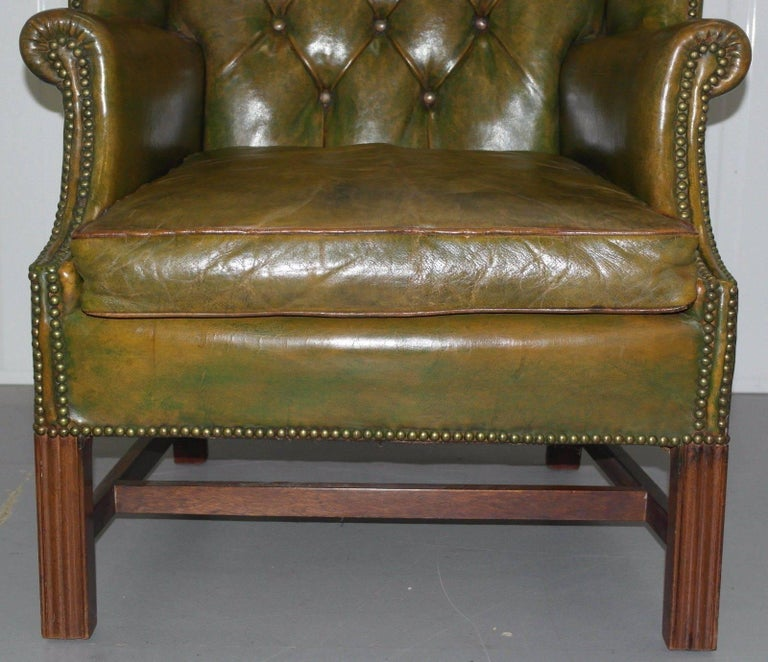 Hand-Carved Georgian Chesterfield Aged Green Leather Wingback Fireside Armchair, George III For Sale