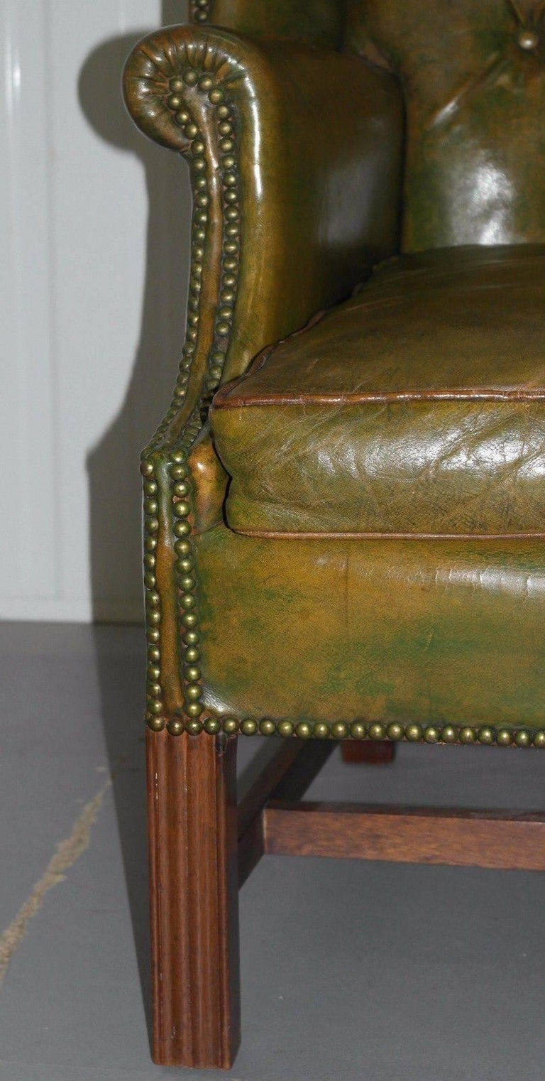 Georgian Chesterfield Aged Green Leather Wingback Fireside Armchair, George III In Good Condition For Sale In London, GB