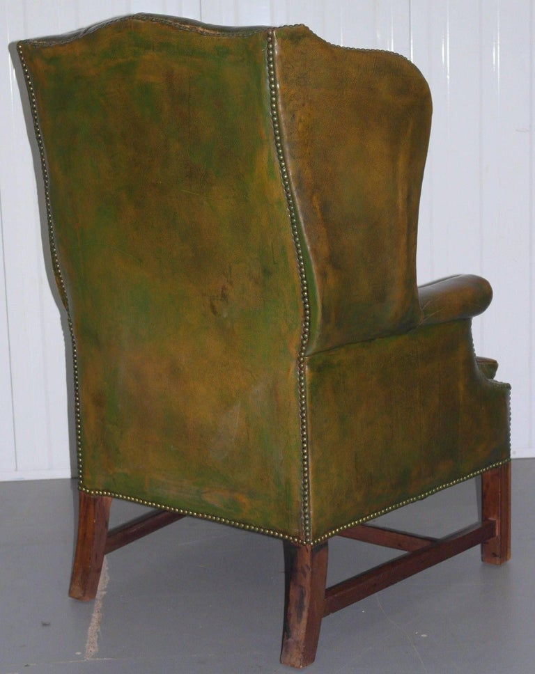 Georgian Chesterfield Aged Green Leather Wingback Fireside Armchair, George III For Sale 4